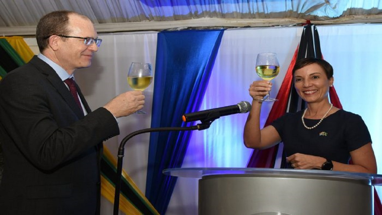 Minister of Foreign Affairs and Foreign Trade, Kamina Johnson Smith, and Charge d' Affaires at the South African High Commission, Phillip Riley, raise their glasses in a toast at a reception to celebrate the 24th Anniversary of South Africa's Freedom Day, held on Thursday at the Terra Nova Hotel in St Andrew.