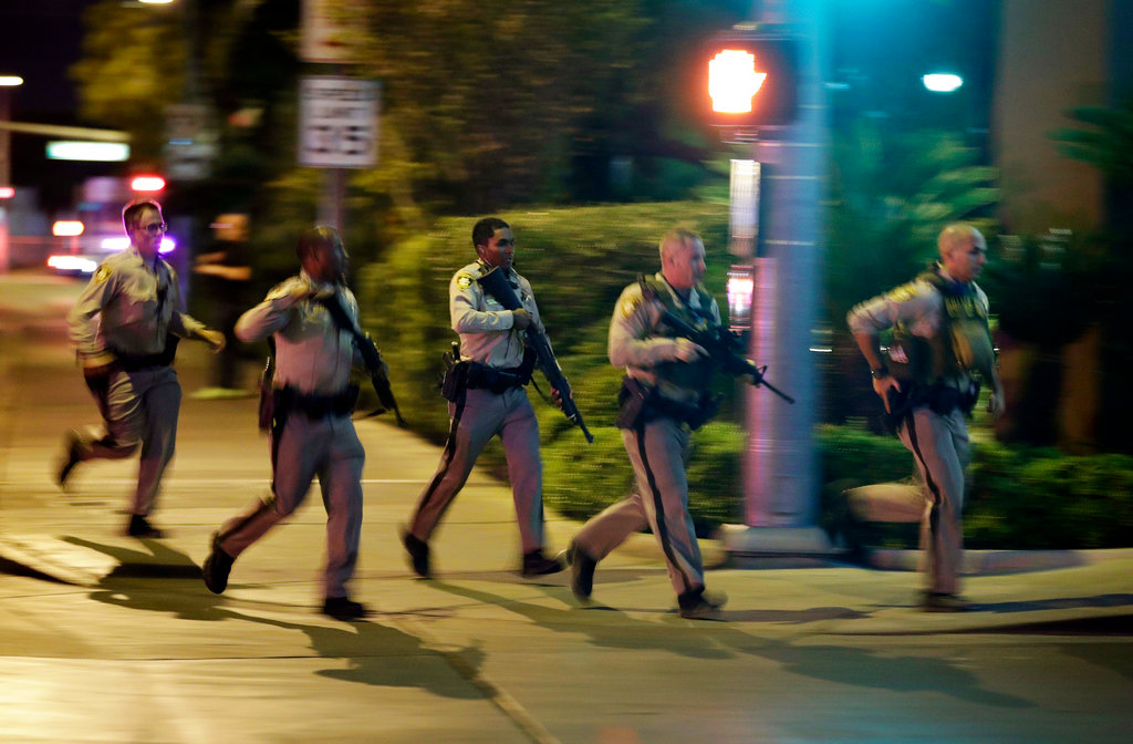 Police run toward the scene of a shooting near the Mandalay Bay resort and casino on the Las Vegas Strip in Las Vegas. (AP Photo/John Locher, File)