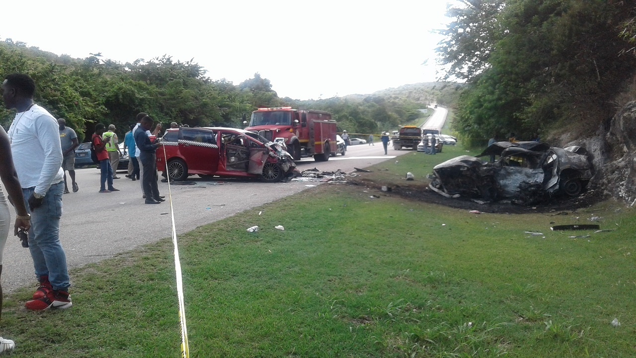 The scene of the fiery two-vehicle collision that resulted in the loss of three lives on the Duncans main road in Trelawny recently.