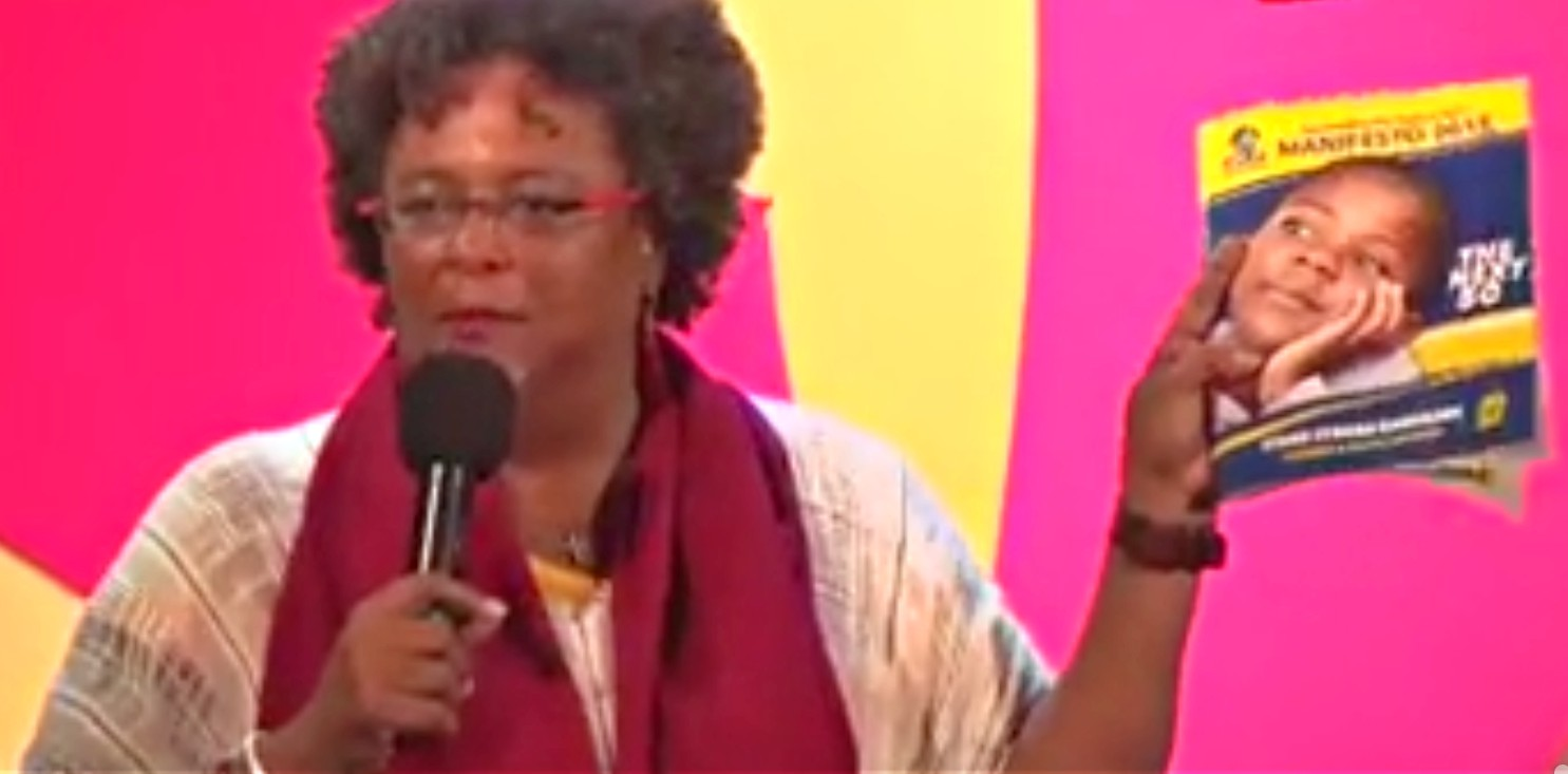 BLP leader, Mia Mottley, holding a copy of the supposed DLP manifesto.