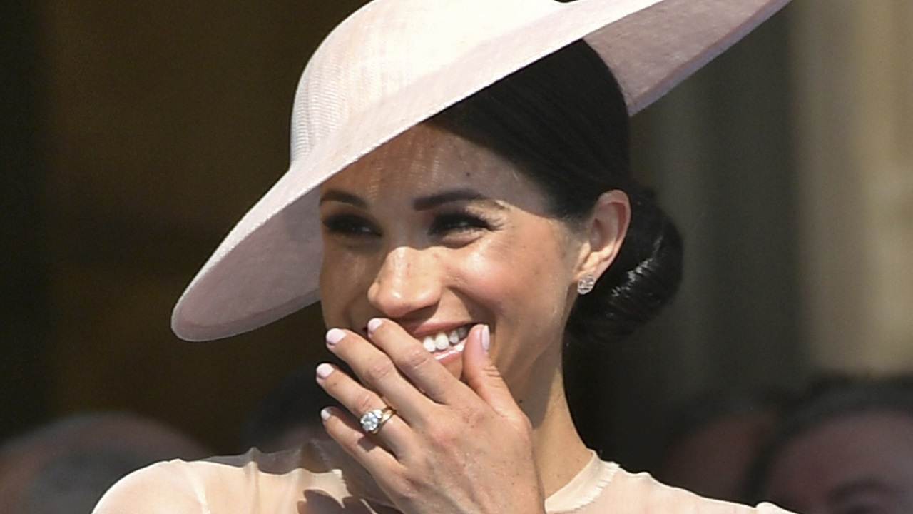 (Image: AP: Meghan, the Duchess of Sussex, at a garden party at Buckingham Palace in London on 22 May 2018)