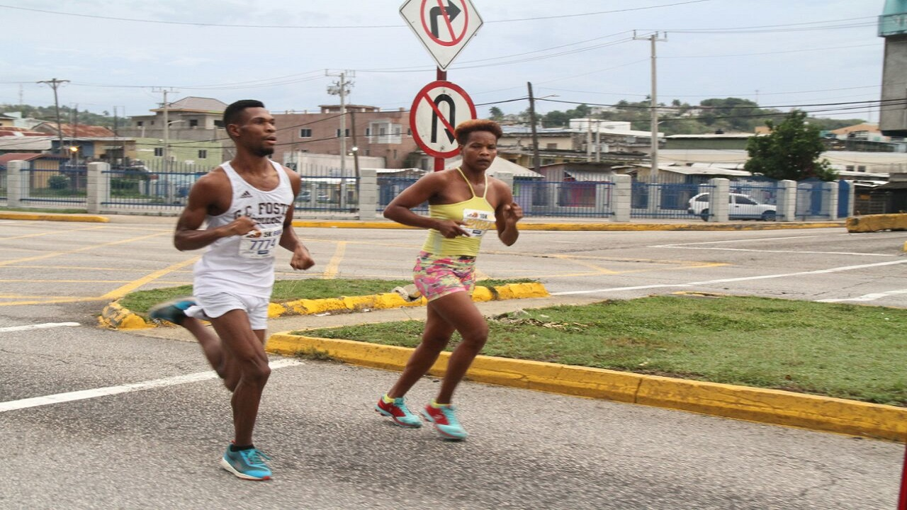 10K Male and 10K Female winners on the road heading back to the finish line at Mobay City Run 2018.
