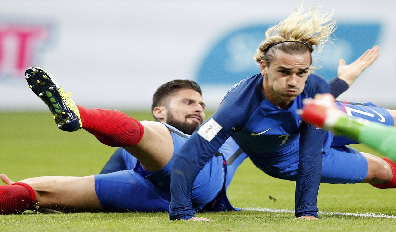 France's Olivier Giroud, left, and France's Antoine Griezmann fall during the World Cup Group A qualifying football match at the Stade de France stadium in Saint-Denis, outside Paris, Tuesday, Oct.10, 2017.