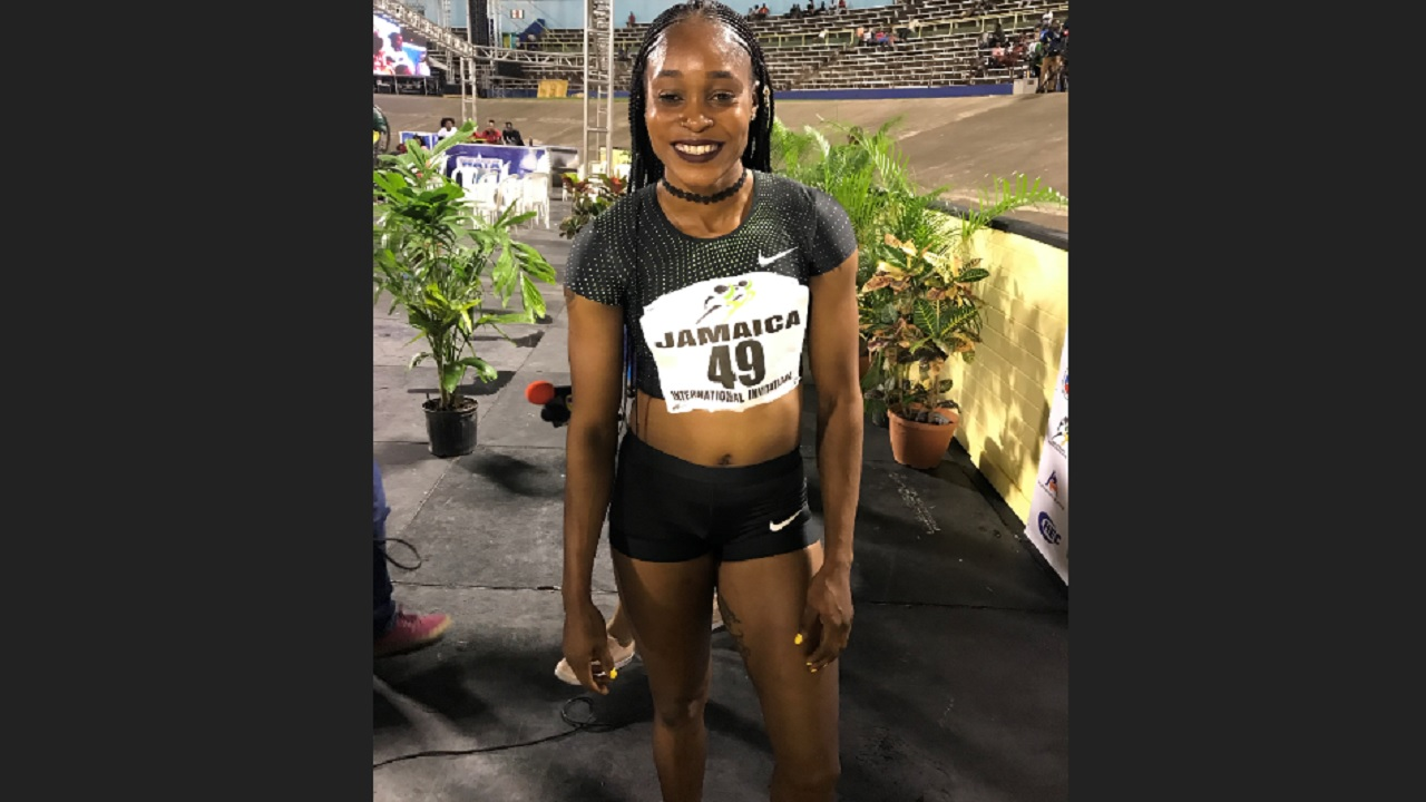 Double Olympic sprint champion Elaine Thompson poses following her victory in the women's 100 metres at the Jamaica International Invitational Meeting at the National Stadium on Saturday night.