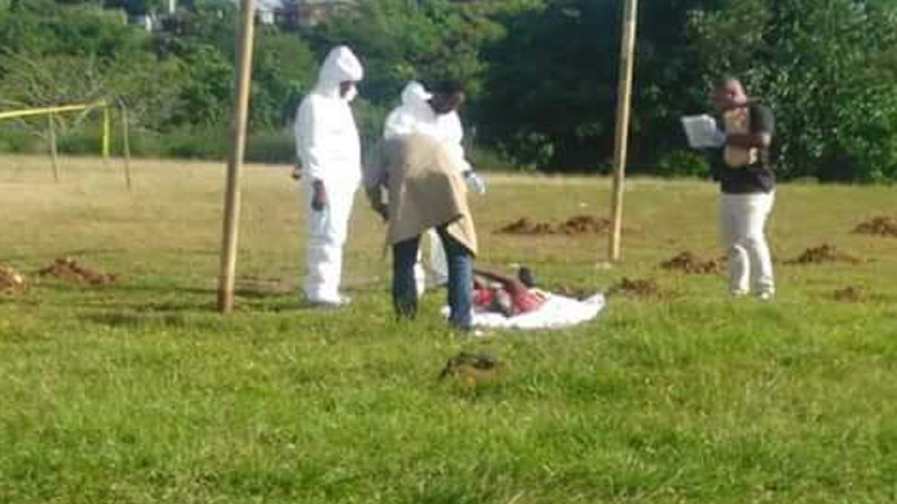 Crime scene investigators on the football field of the Horace Clarke High School in Islington, St Mary, where one of two men who were shot dead in a confrontation with the police on Friday night, was later found.