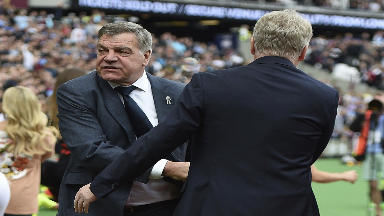 Everton manager Sam Allardyce, left, shakes hands with West Ham manager David Moyes.