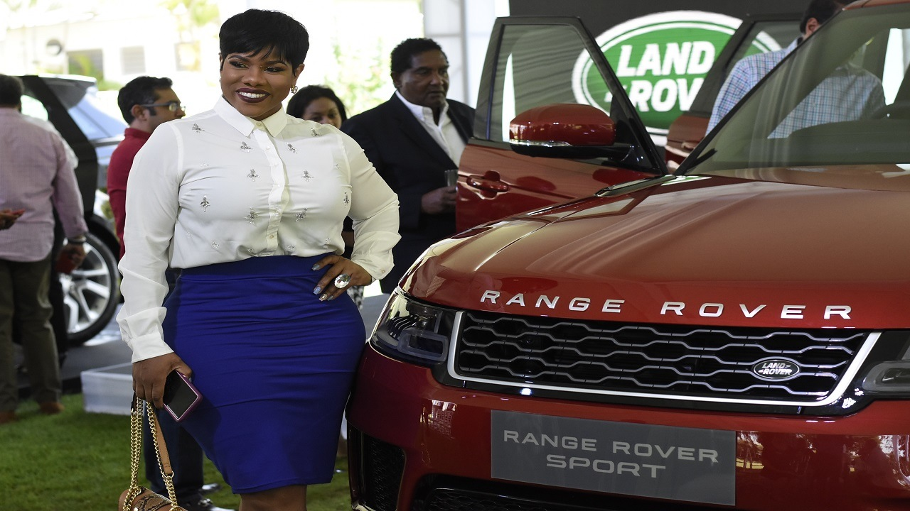 Popular media personality Miss Kitty poses beside the new Range Rover Sport at the launch earlier this week. (PHOTOS: Marlon Reid)