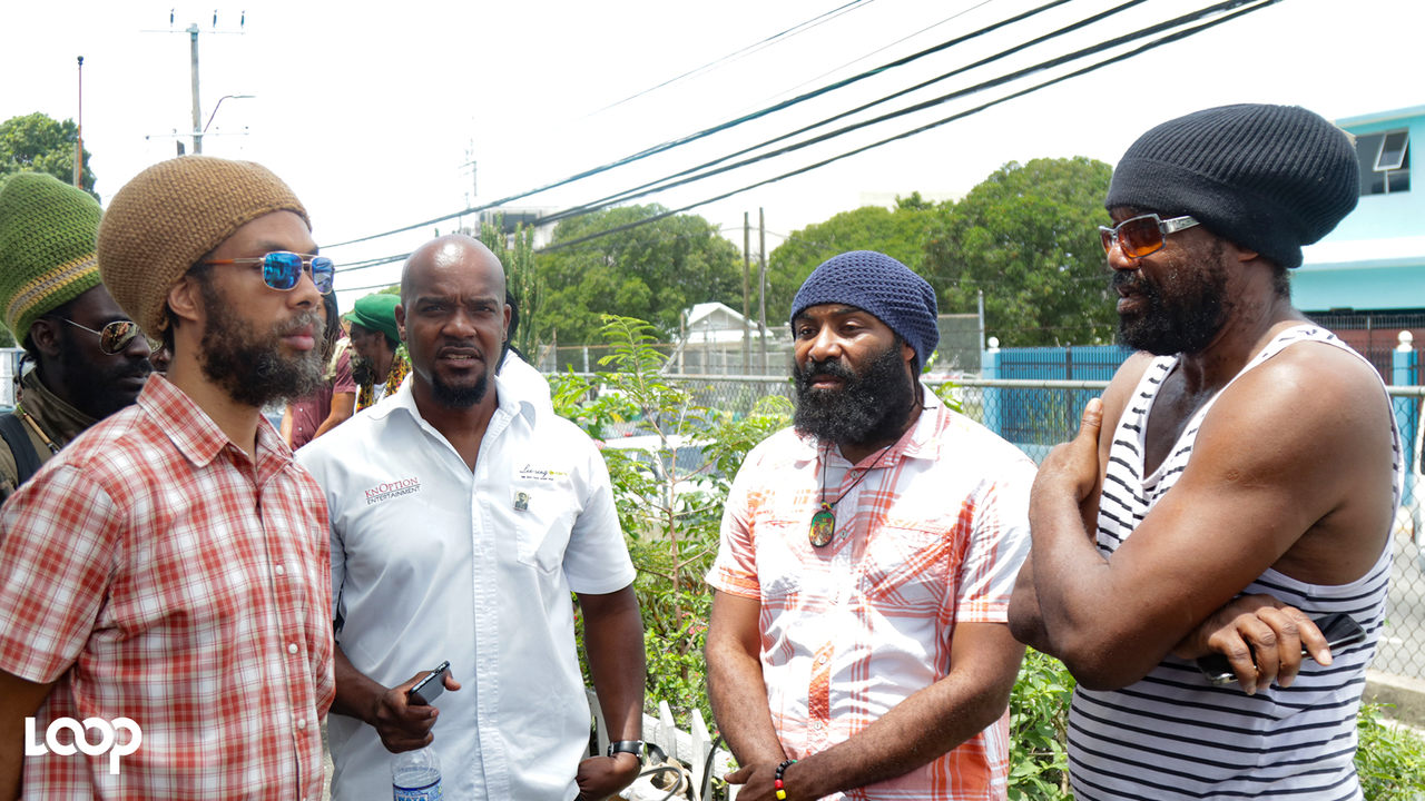 Tony Rebel (right) and Anthony Cruz (second right) were among the entertainers who showed support for Capleton at the Kingston and St Andrew Parish Court on Monday. (PHOTO: Shawn Barnes)