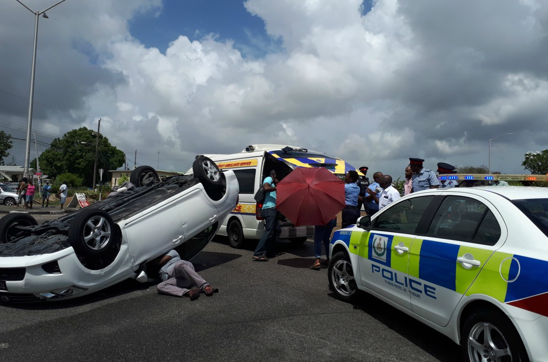 The overturned vehicle (right) was driven by Nicole Alleyne who had to be transported by ambulance to the QEH.