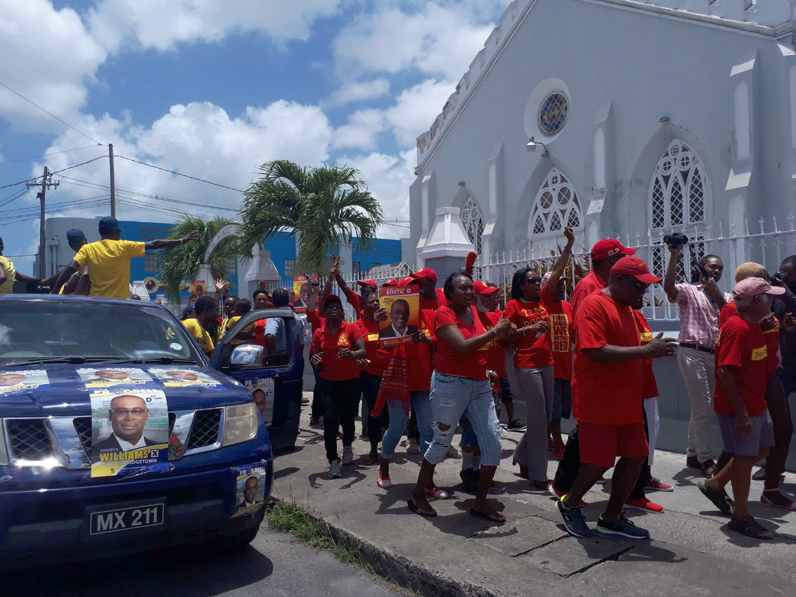 DLP party supporters leaving the Bethel Church nomination center as supporters of the BLP arrive.