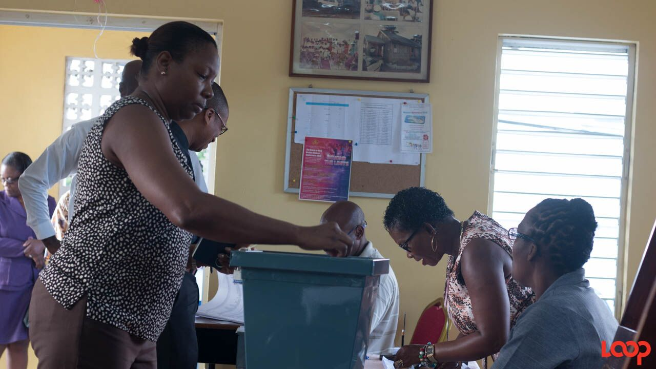 Persons voting at the Lester Vaughan School in St Thomas.