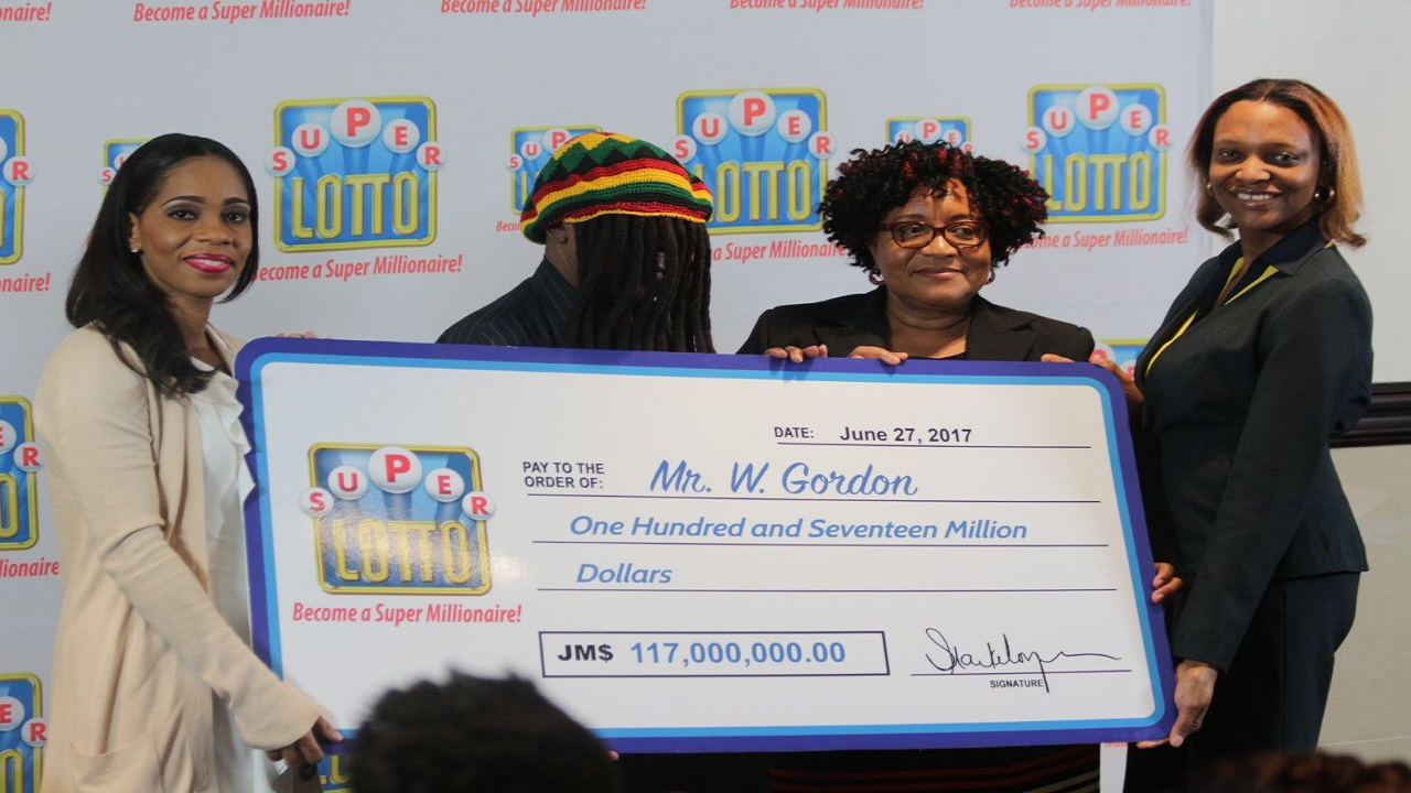 Super Lotto winner W Gordon with (from left) Simone Clarke-Cooper, assistant vice president at Supreme Venture Limited (SVL), BGLC inspector Marcia Richardson and SVL corporate communication assistant Rachael Dixon.
