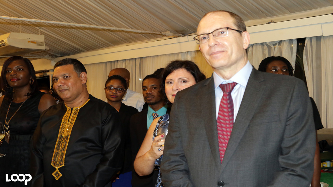 Charge d'affaires of the South African High Commission Philip Riley (right), with guests at his country's National Day celebrations recently.
