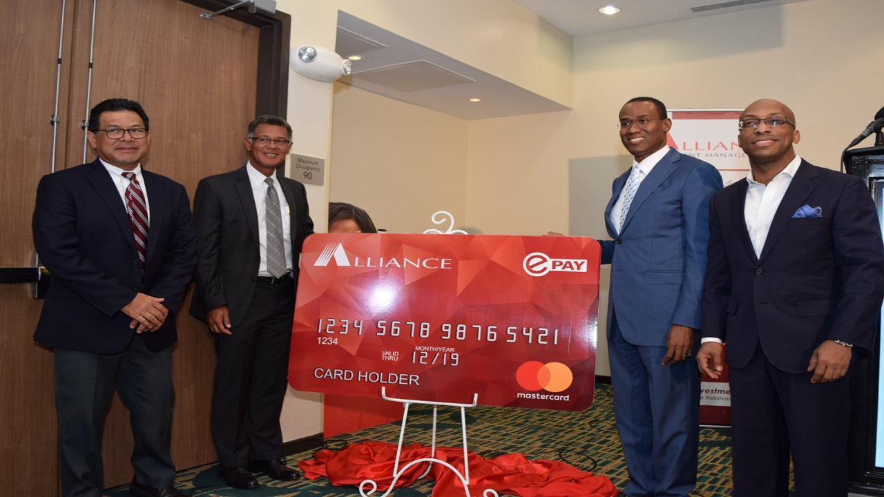 From left: Alliance Vice President Robert Chin; Alliance President Peter Chin; Minister of Finance Dr Nigel Clarke; and MasterCard Country Manager Uhriel Bedoya. (Photo contributed).