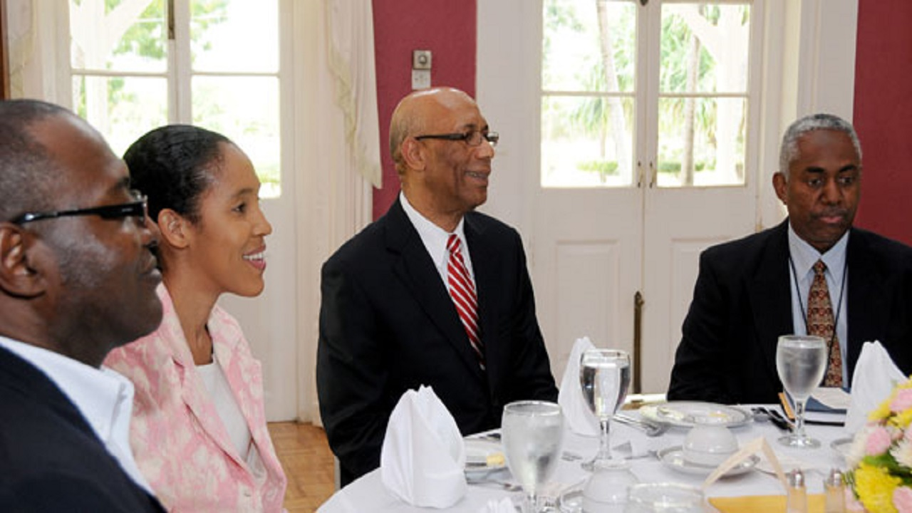 Garfield Grandison (left) in the company of Governor General, Sir Patrick Allen (second right), at a luncheon at Kings House, which was attended by, among other media practitioners, Chief Executive Officer of the Jamaica Information Service (JIS), Donna-Marie Rowe; and Vernon Davidson, Executive Editor – Publication at the Jamaica Observer newspaper.