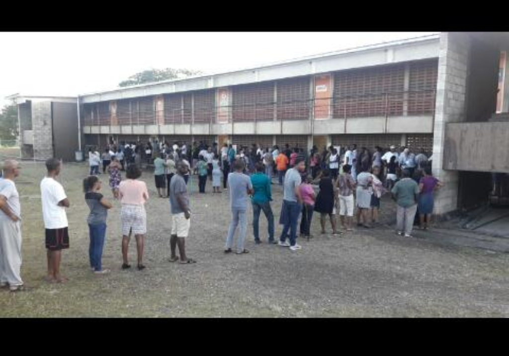 Persons line up to vote at the West Terrace Primary School.