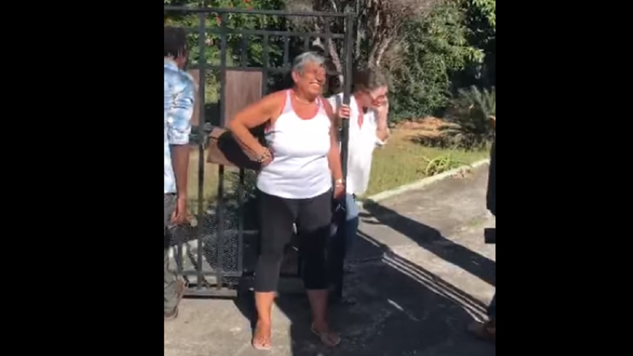 A screenshot from a video with attorney Jennifer Messado (centre foreground) on a visit to a property in St Andrew, reportedly the one relative to an ongoing police investigation.