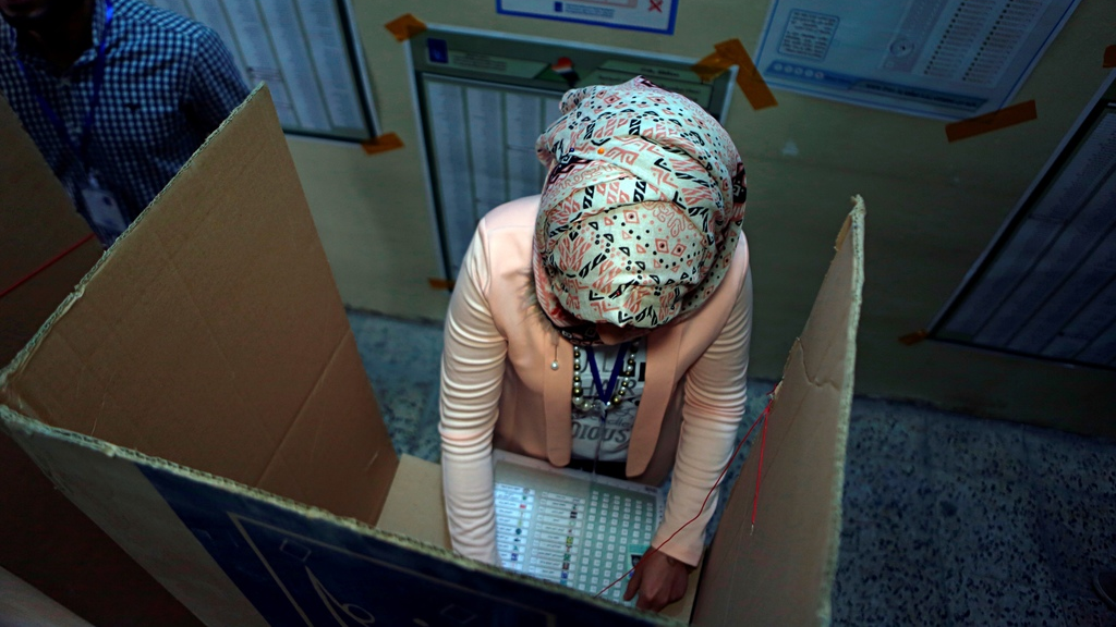 An Iraqi woman casts her vote in the country's parliamentary elections in Baghdad, Iraq, Saturday, May 12, 2018. Polls opened across Iraq on Saturday in the first national election since the declaration of victory over the Islamic State group. (AP Photo/Khalid Mohammed)