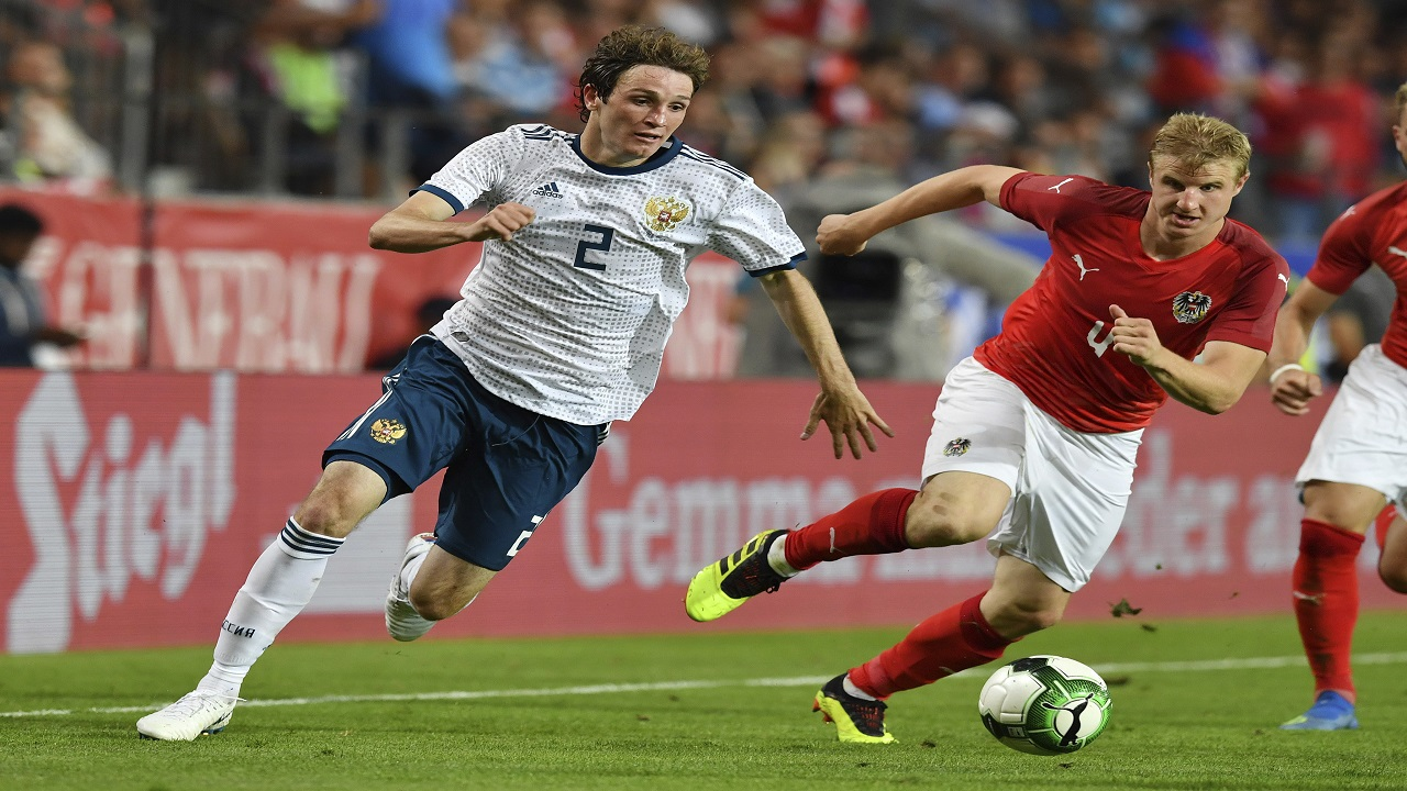 Austria's Martin Hinteregger, right, and Russia's Mario Fernandes challenge for the ball during the friendly football match between Austria and Russia in the Tivoli Stadium in Innsbruck, Austria, on Wednesday, May 30, 2018. (AP Photo/Kerstin Joensson)