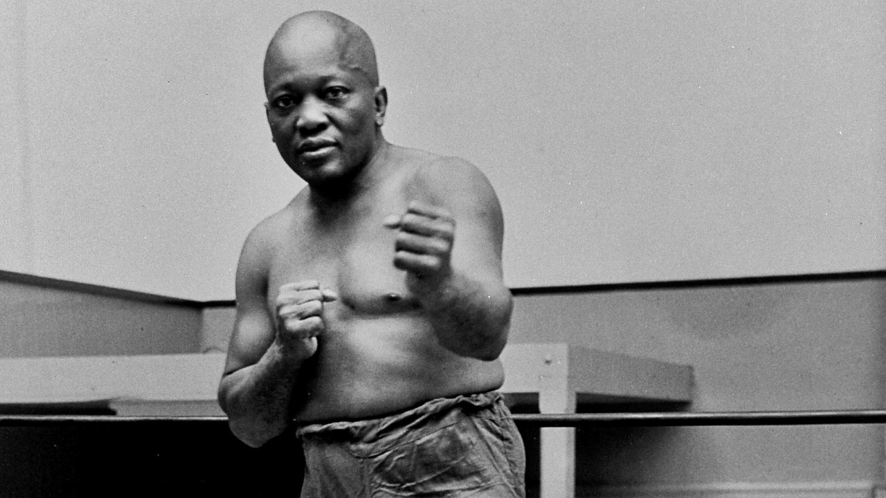 (Image: AP: Boxer Jack Johnson, pictured in 1932)