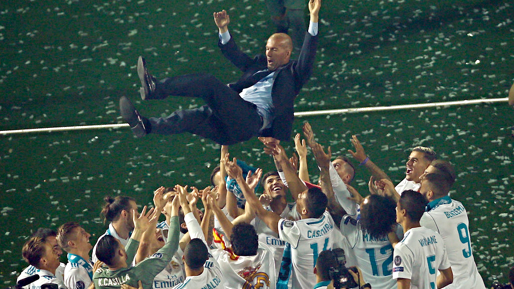 Real Madrid players lift head coach Zinedine Zidane into the air as they celebrate after winning the Champions League final, at the Santiago Bernabeu stadium in Madrid, Spain, Sunday, May 27, 2018. (AP Photo/Francisco Seco)
