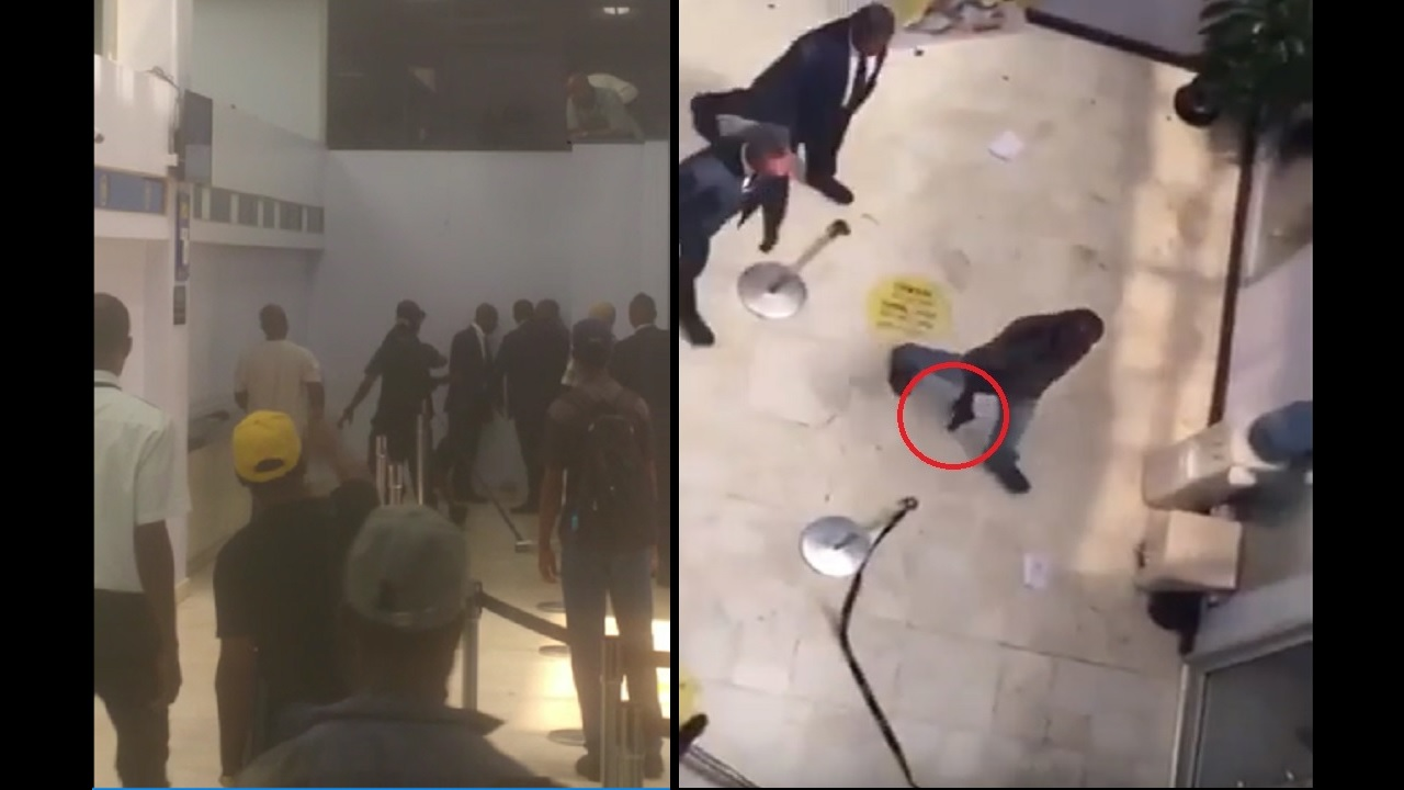 Screenshots of a video showing the moments after a man pulled a gun inside the Half Way Tree NCB branch.