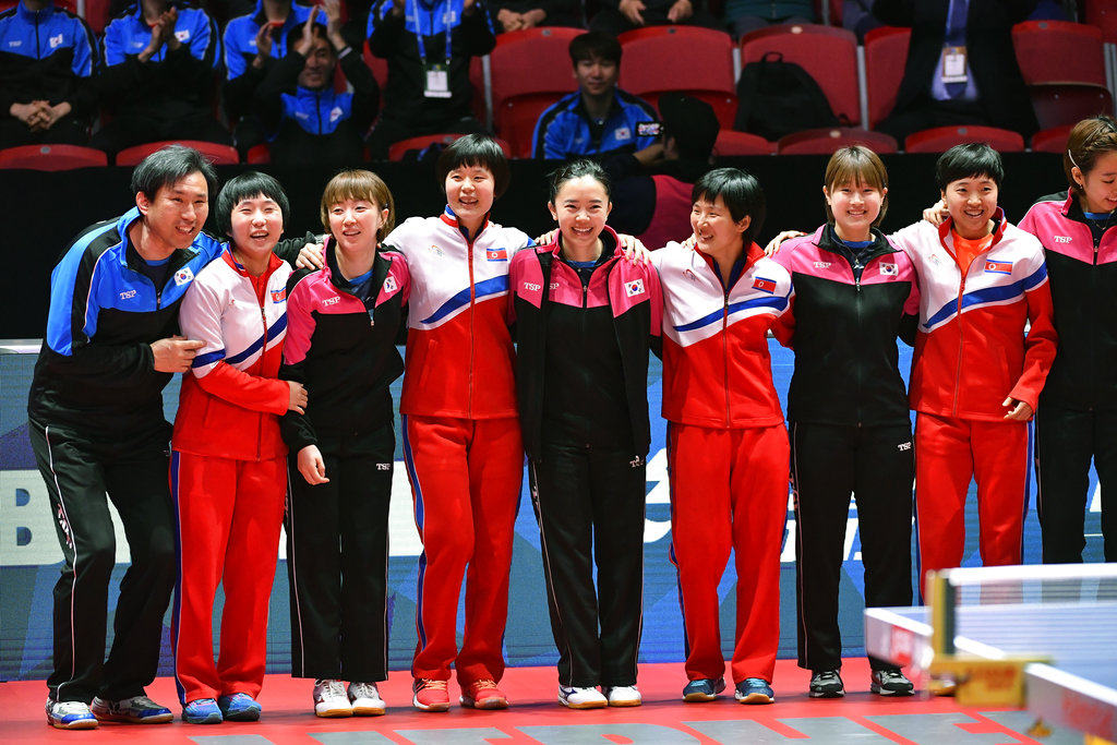 Members of North Korea and South Korea table tennis teams pose together for a group photo after deciding to combine their teams to avoid playing against each other in the Quarter Finals of the World Team Table Tennis Championships at Halmstad Arena in Halmstad, Sweden. (Jonas Ekstromer/TT via AP)