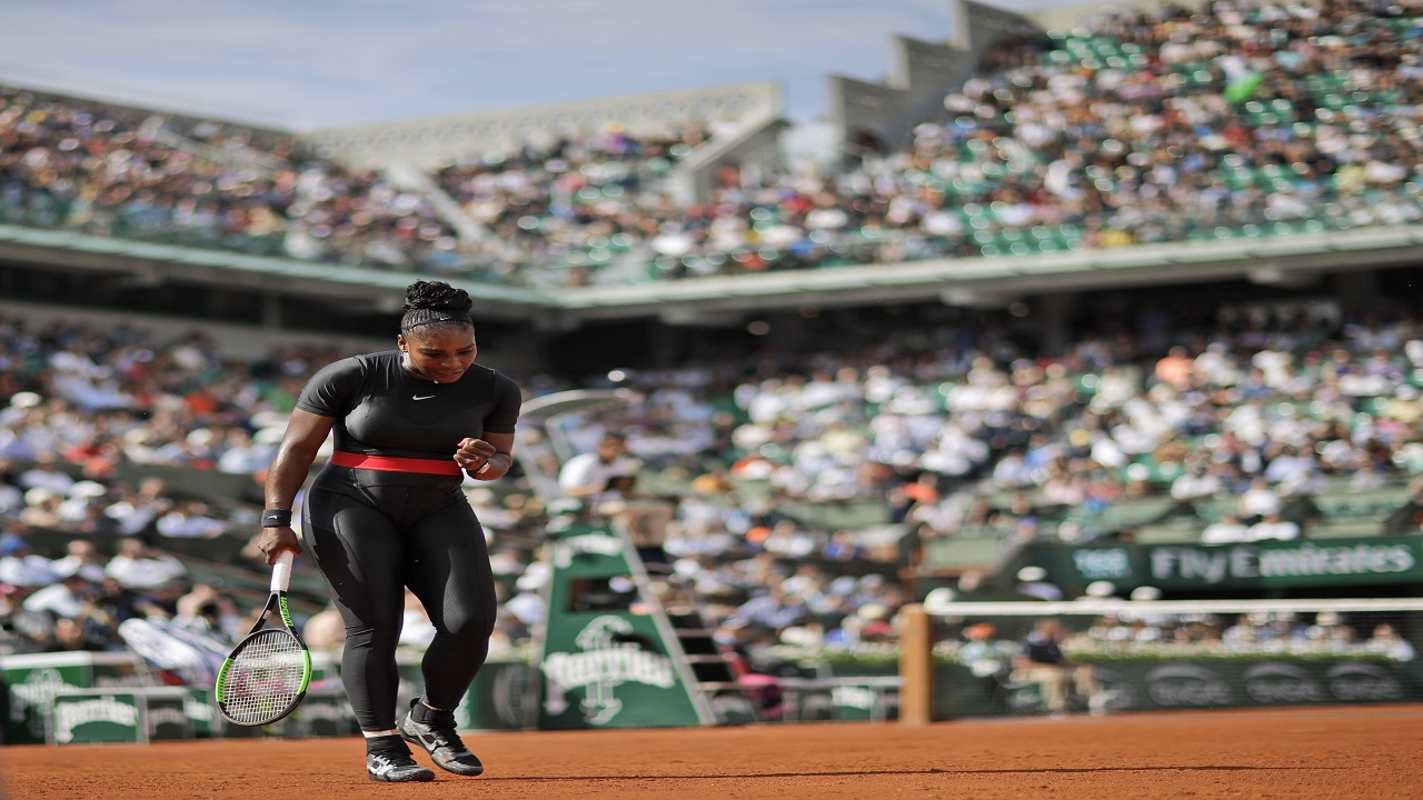 Serena Williams of the U.S. clenches her fist after scoring a point against Krystina Pliskova of the Czech Republic during their first round match of the French Open tennis tournament at the Roland Garros stadium in Paris, France, Tuesday, May 29, 2018.  (AP Photo)