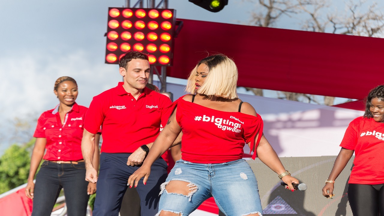 Digicel Jamaica CEO Justin Morin (centre) gets in the groove with Digicel brand ambassador, Miss Kitty and Marketing Manager Monique McLeod (left) at a recent Destination Data roadshow.