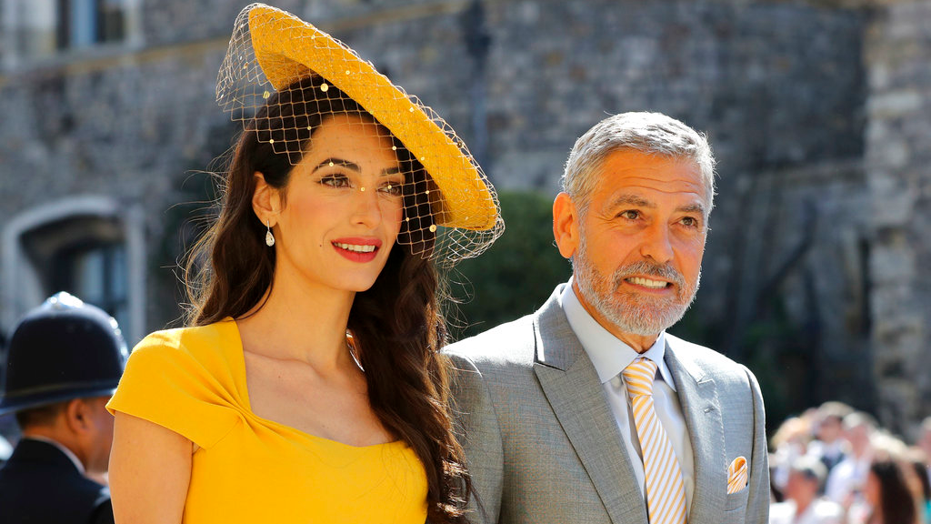 Amal Clooney and her husband George Clooney arrive for the wedding ceremony of Prince Harry and Meghan Markle at St. George's Chapel in Windsor Castle in Windsor, near London, England, Saturday, May 19, 2018. (Odd Anderson/pool photo via AP)