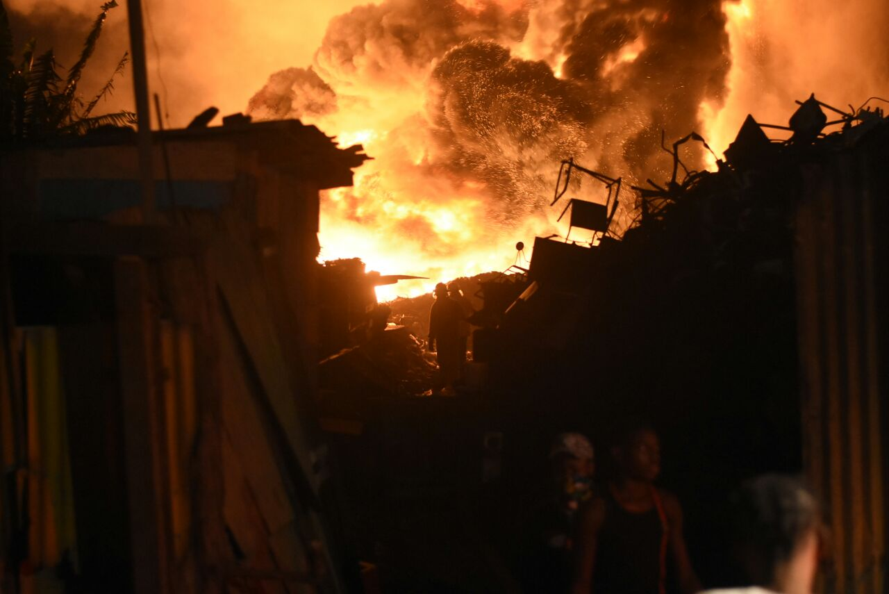 The huge fire which developed among stored used tyres in the Riverton Meadows community in St Andrew on May 5.