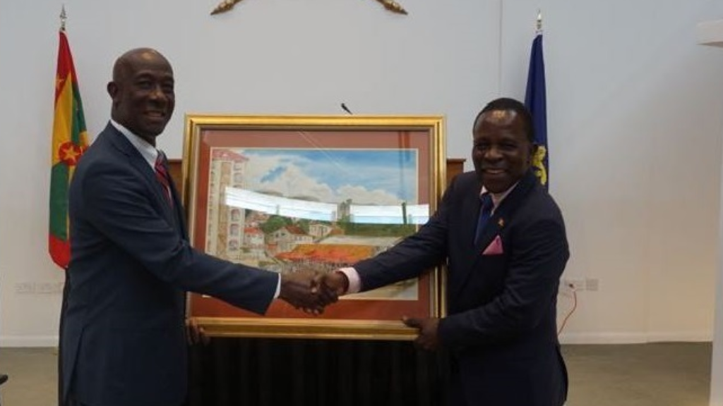 Prime Minister Rowley presents Prime Minister Mitchell with a gift to the people of Grenada on behalf of the people of Trinidad and Tobago