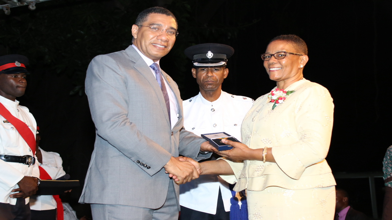 Prime Minister Andrew Holness presented 40 teachers with the Medal of Appreciation for their service to education at a ceremony held at Jamaica House on Wednesday. (PHOTOS: Llewellyn Wynter)