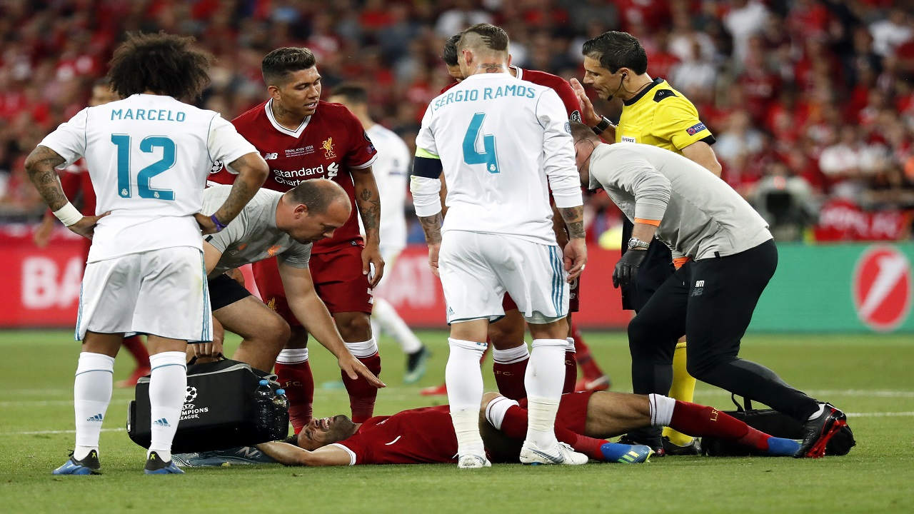 Liverpool's Mohamed Salah lies on the pitch after a collision with Real Madrid's Sergio Ramos during the Champions League Final on Saturday. (PHOTO: AP)