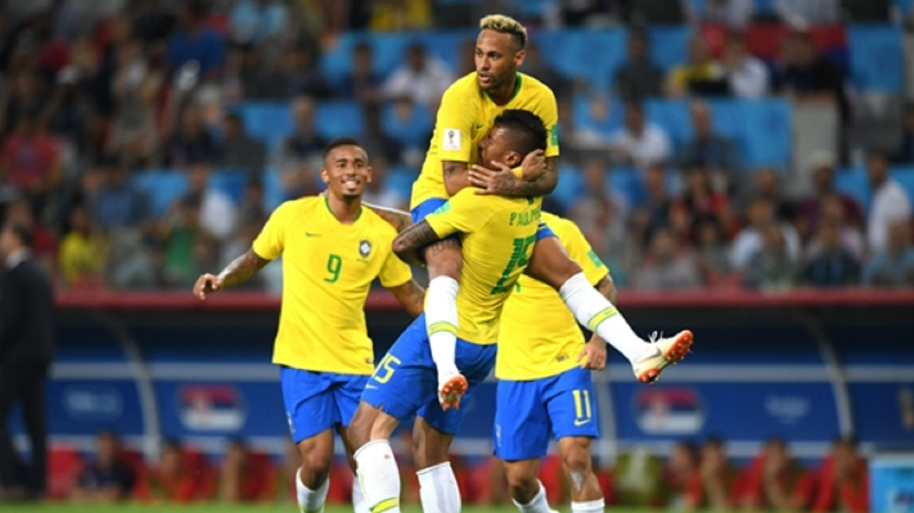 Brazil players celebrate a goal against Serbia.