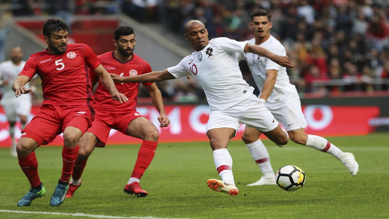 Portugal's Joao Mario, 2nd right, attempts a shot at goal during a friendly soccer match between Portugal and Tunisia in Braga, Portugal, Monday, May 28, 2018.