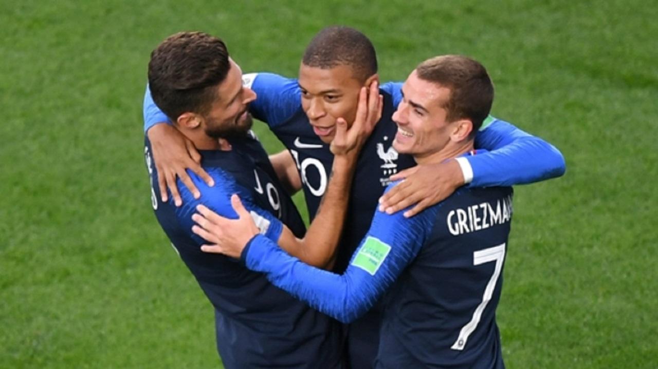 France celebrate a Kylian Mbappe goal.
