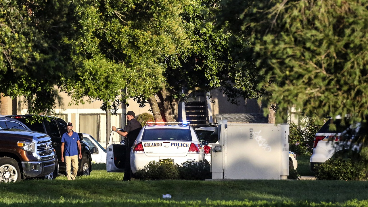 (Image: AP: Police at the  scene of the shooting in Florida on 11 June 2018)