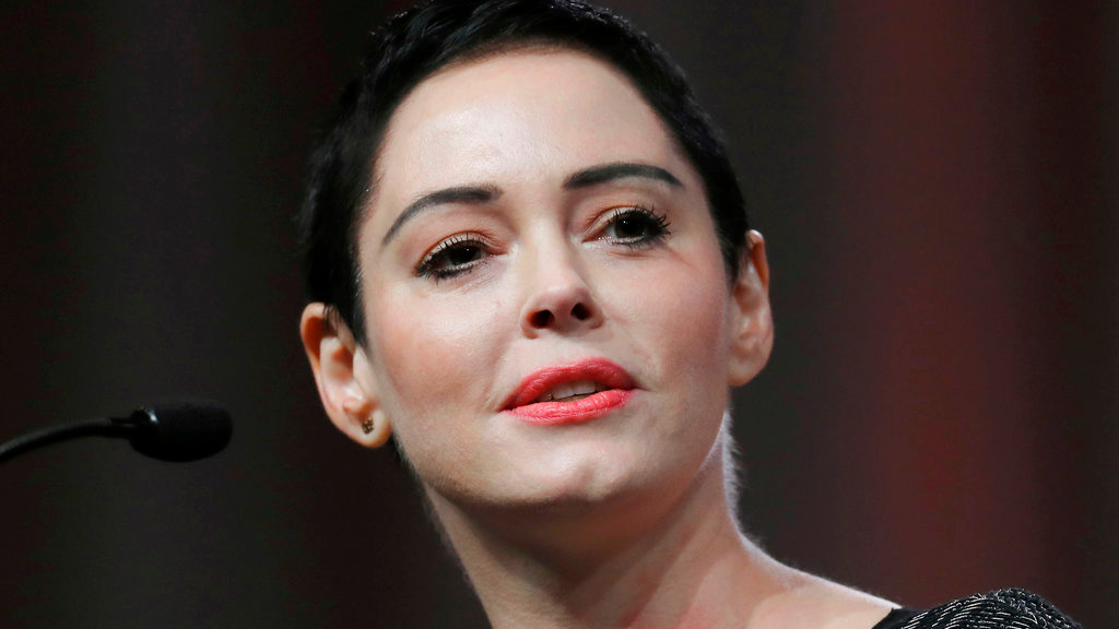 FILE- In this Oct. 27, 2017, file photo, actress Rose McGowan speaks at the inaugural Women's Convention in Detroit. (AP Photo/Paul Sancya, File)