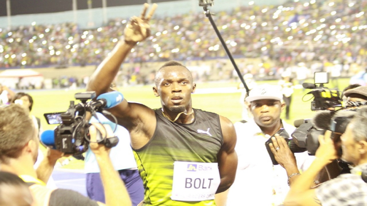 Eight-time Olympic champion Usain Bolt acknowledges the National Stadium crowd after winning the 'Salute a Legend' 100m race at the second staging of the JN Racers Grand Prix last year. It was Bolt's final race in his native Jamaica. The meet  was used to celebrate the achievements of the world's fastest man. Bolt retired from track and field following the London World Championships in August of last year. (PHOTO: Marlon Reid).