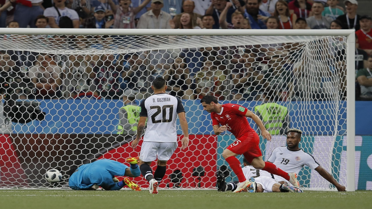 Switzerland's Blerim Dzemaili, second right, scores past Costa Rica goalkeeper Keylor Navas, left, the opening goal during the group E match  at the 2018 football World Cup in the Nizhny Novgorod Stadium in Nizhny Novgorod , Russia, Wednesday, June 27, 2018. (AP Photo/Vadim Ghirda)
