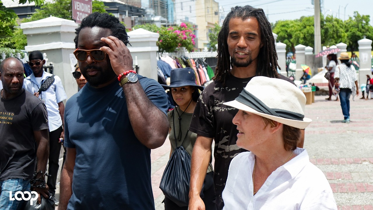 Justine Henzell with Marlon James (left) and Akala in downtown Kingston on Tuesday. (PHOTOS: Shawn Barnes)