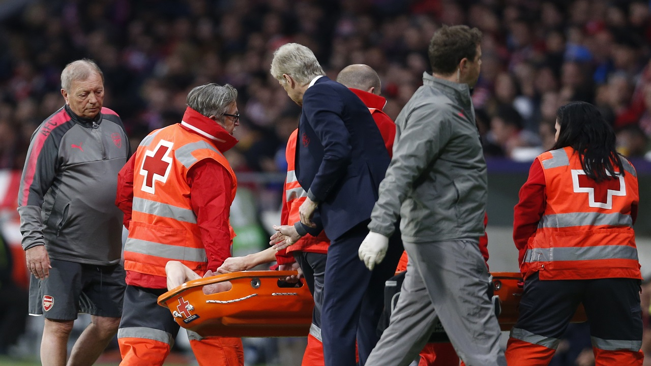 Arsenal's Laurent Koscielny leaving the field on a stretcher after injuring himself during the Europa League semifinal, second leg football match against Atletico Madrid at the Metropolitano stadium in Madrid, Spain, Thursday, May 3, 2018.