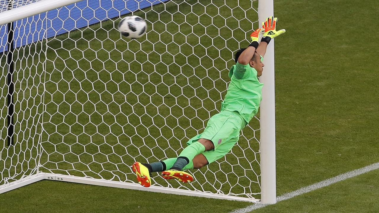 Costa Rica goalkeeper Keylor Navas losses a goal scored by Serbia's Aleksandar Kolarov during the group E match  at the 2018 football World Cup in the Samara Arena in Samara, Russia, Sunday, June 17, 2018. (AP Photo/Vadim Ghirda).