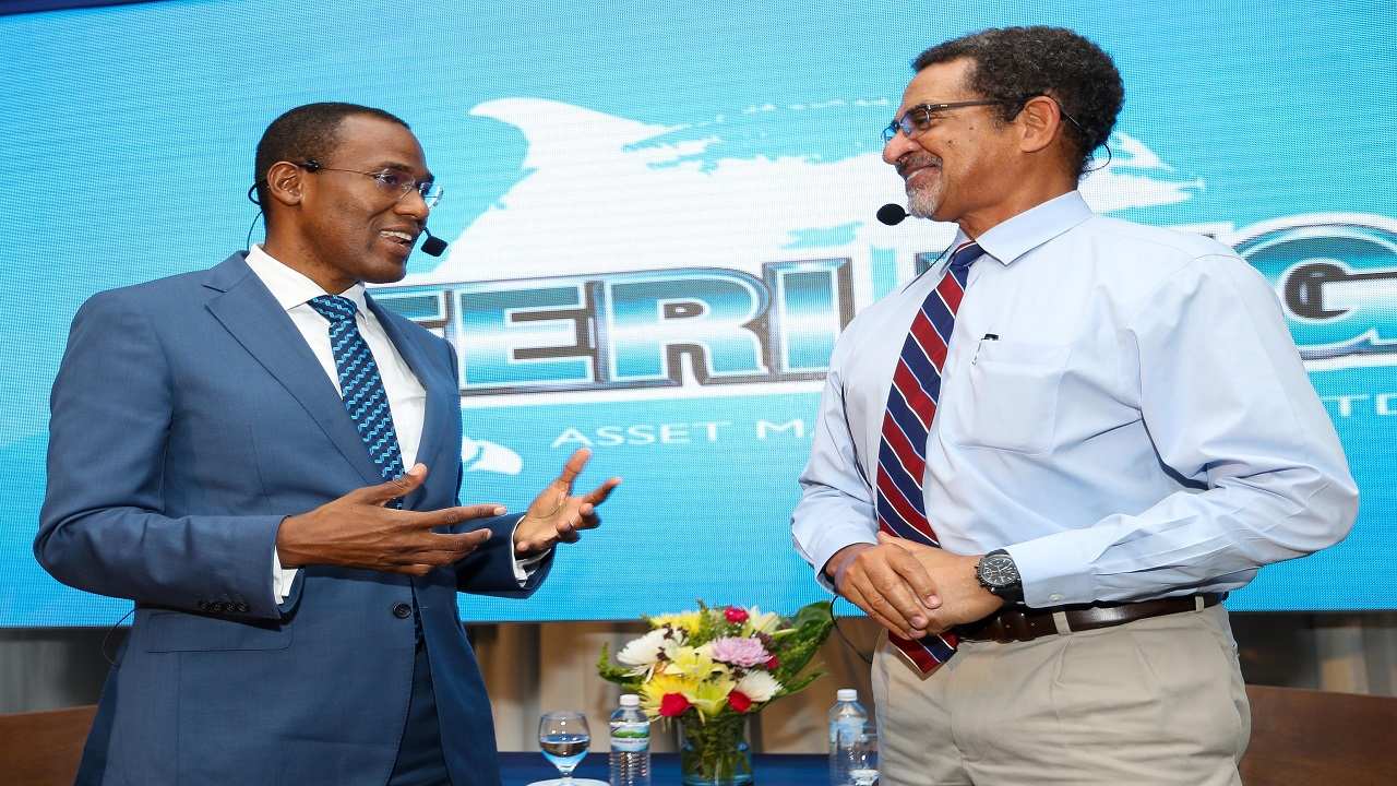 Finance Minister Dr Nigel Clarke (left) recently engaged in a candid fireside chat about Jamaica's economic growth with Sterling Asset Management CEO Charles Ross (right).
