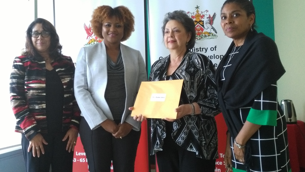 From Left: Permanent Secretary Mrs. Angela Edwards, Dr. the Honourable Nyan Gadsby-Dolly, Mrs. Rosalind Gabriel, and Deputy Permanent Secretary Ms. Susan Shurland after the presentation of her Letter of Appointment to the NCC's Board of Commissioners.