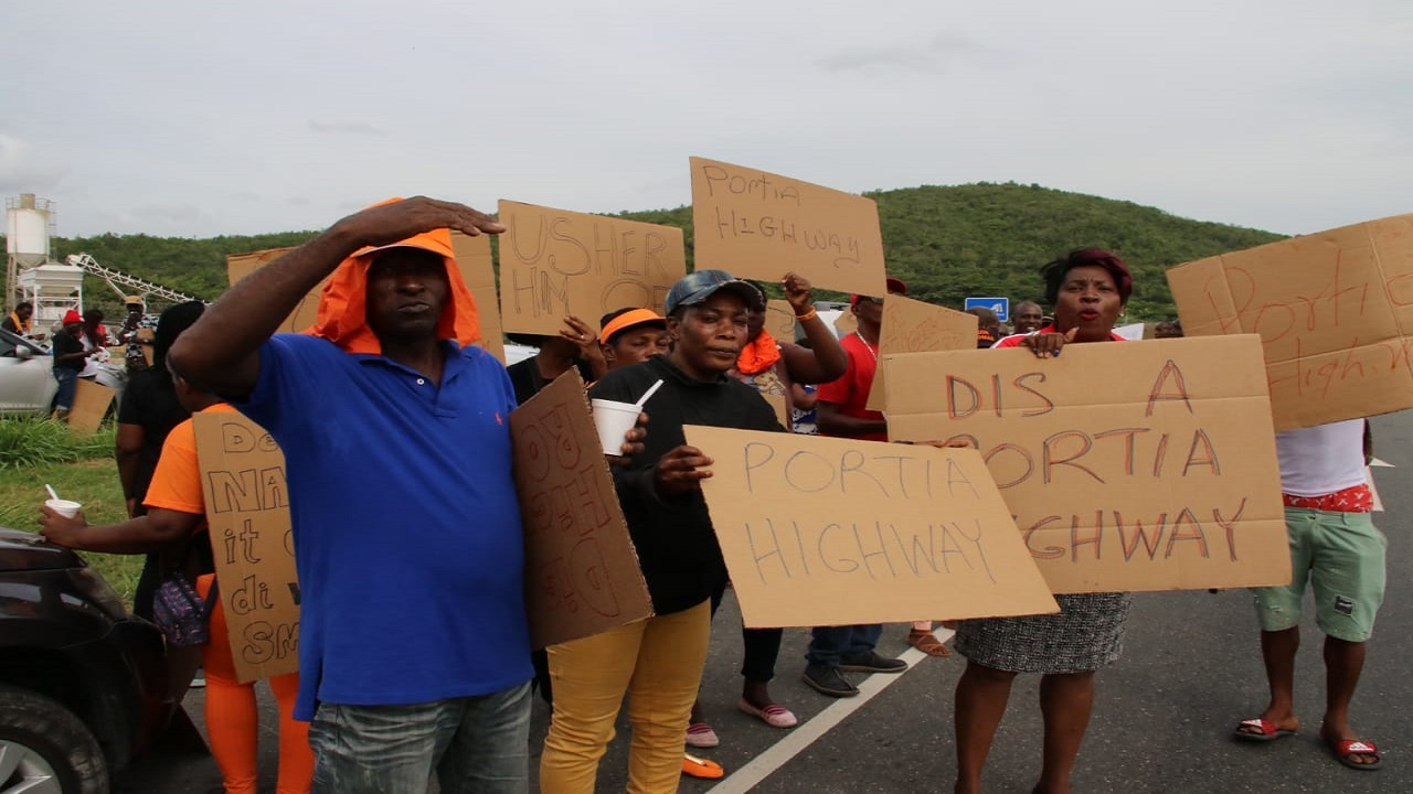 "Led by party Chairman, Fitz Jackson,comrades chanted ""Highway thief, highway robbery"".