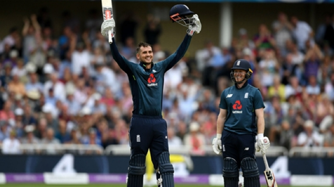 Alex Hales celebrates his century with captain Eoin Morgan.
