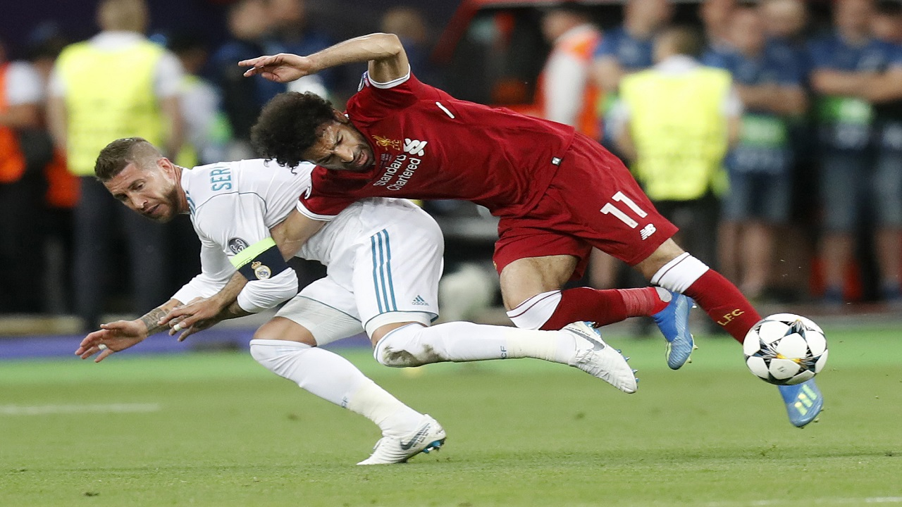 In this Saturday, May 26, 2018 file photo Real Madrid's Sergio Ramos, left, fouls Liverpool's Mohamed Salah during the Champions League Final football match between Real Madrid and Liverpool at the Olimpiyskiy Stadium in Kiev, Ukraine. (AP Photo/Efrem Lukatsky, File)