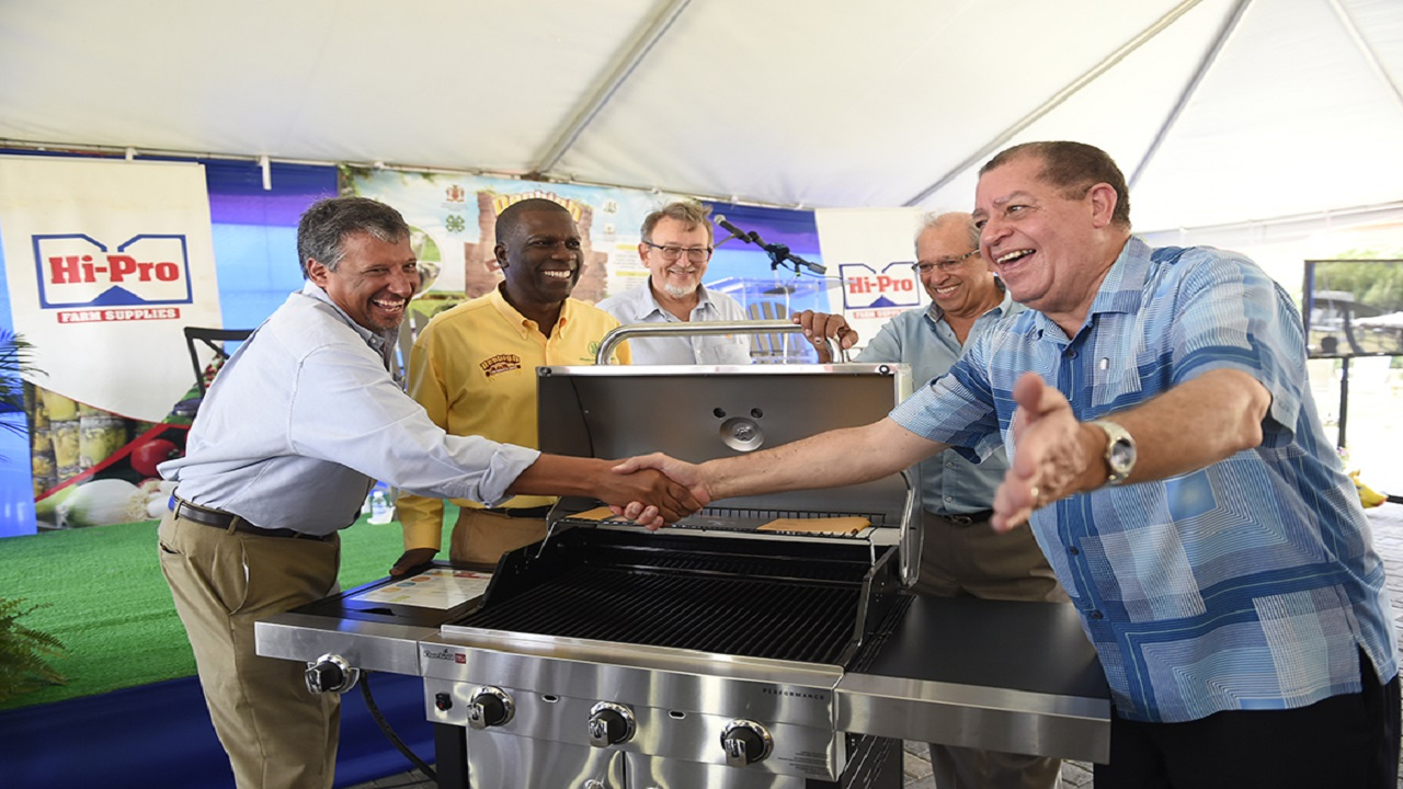 Agriculture Minister, Audley Shaw (right), is surprised with a birthday gift of a barbecue grill from the Jamaica Broilers Group.  Pictured (l-R) are Christopher Levy, President and CEO of Jamaica Broilers Group; Norman Grant, JAS President; Conley Salmon, President, Jamaican Operations, Jamaica Broilers Group; and Robert Levy, Chairman of Jamaica Broilers Group. The presentation was made on Friday at the launch of Denbigh 2018 on the lawn of Hi-Pro, White Marl, St Catherine.